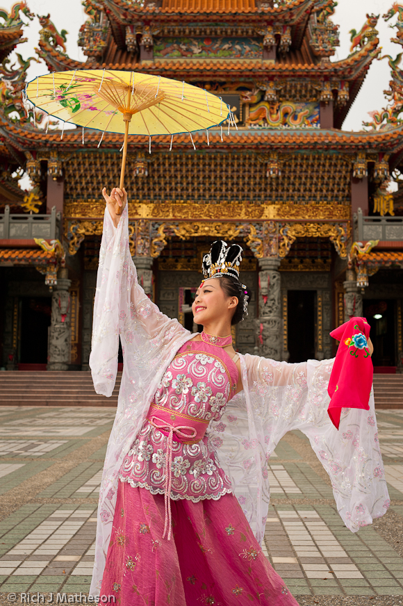 Jiazi 'Chinese Fairy Dancer' poses with umbrella, Guiren District, Tainan City, Taiwan