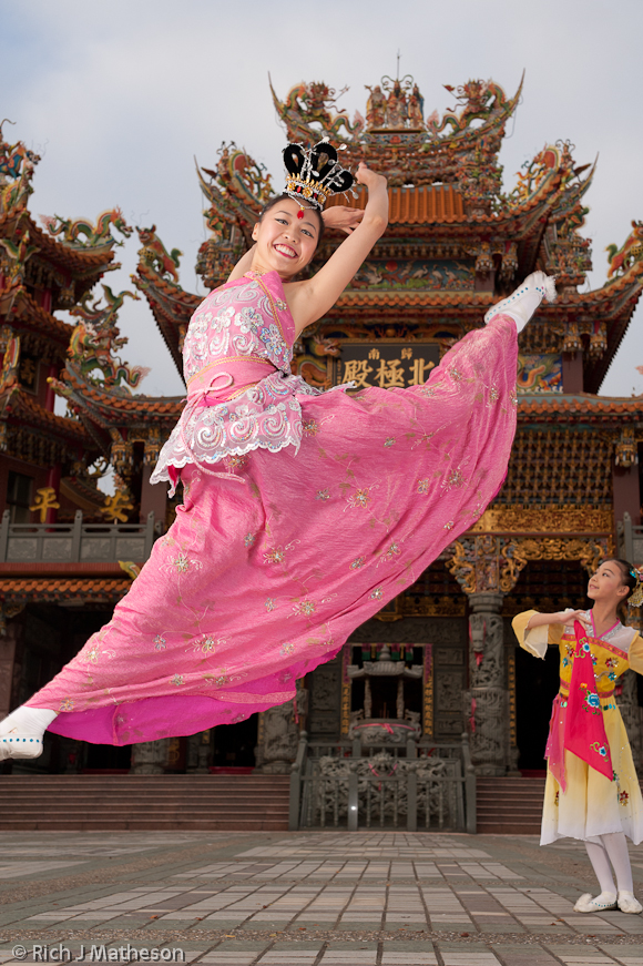 Jiazi Fairy dancer leaps over young dancer in front of Guiren's Beiji Temple, Tainan City, Taiwan