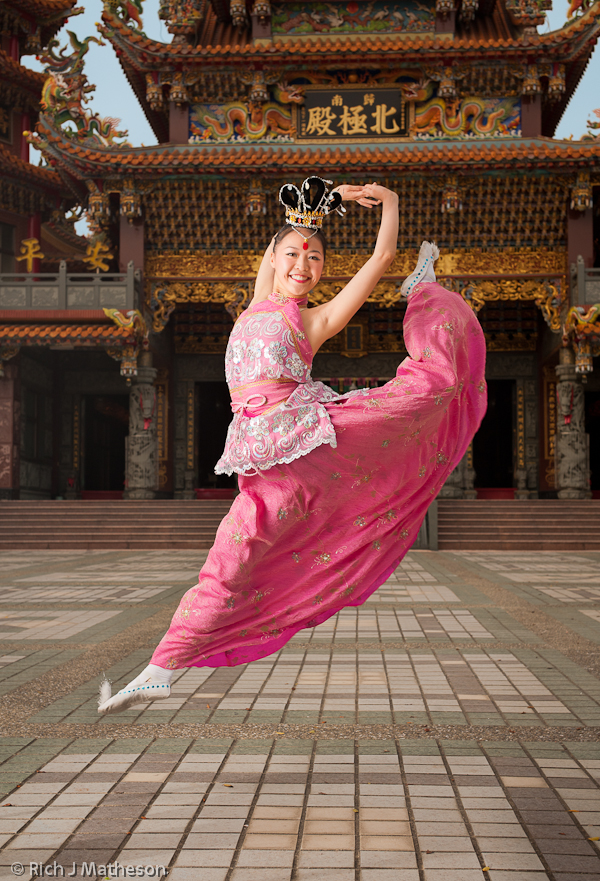 Jiazi Dancer leaps in front of Guiren's Beiji Temple.
