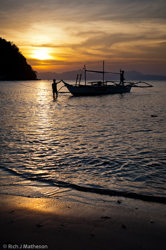 banka (pump-boat) and sunset, Coron, Palawan Island, Philippines