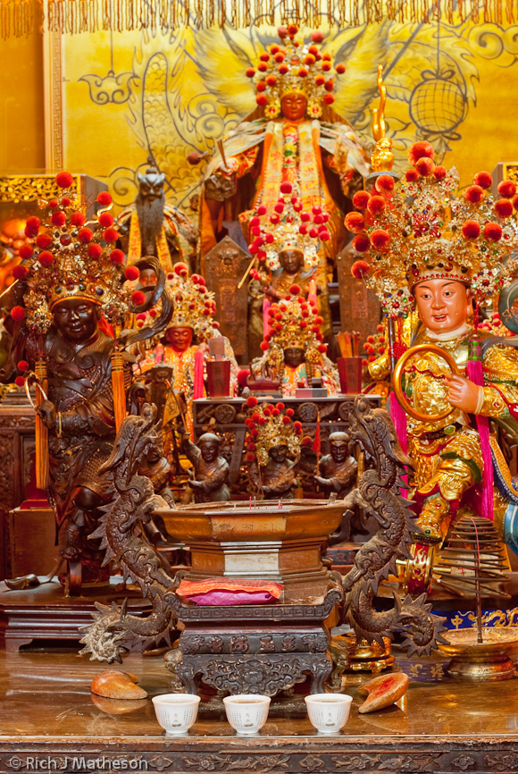 Gods and offerings on temple altar, Tainan City, Taiwan