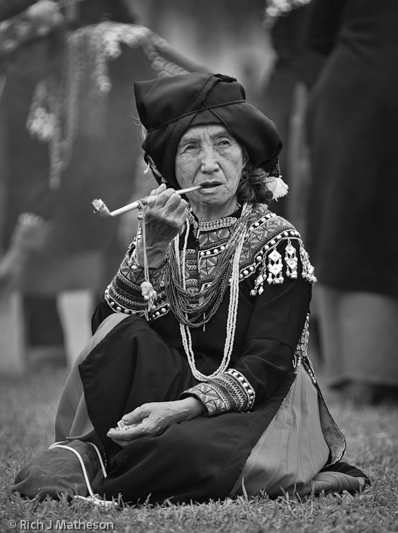 Bunun Aboriginal Woman Smokes a Pipe at Ear Festival in Namasia