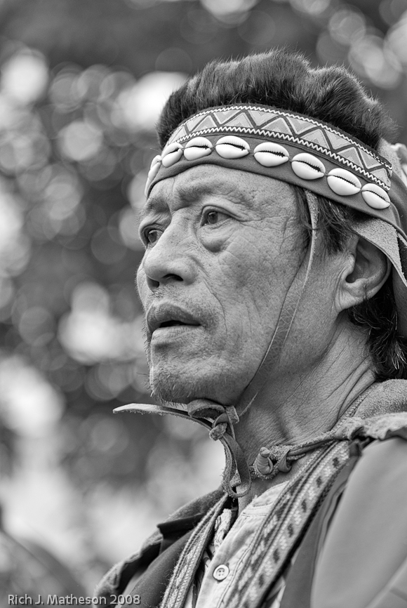 Portrait of Chou Tribesman in traditional clothing.