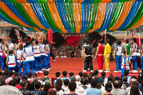 Crowds of spectators watch at front and back of stage as Long Hua College Competes in the Creative Song-Jiang Jhen Contest, College Cup in Neimen, Kaohsiung City, Taiwan