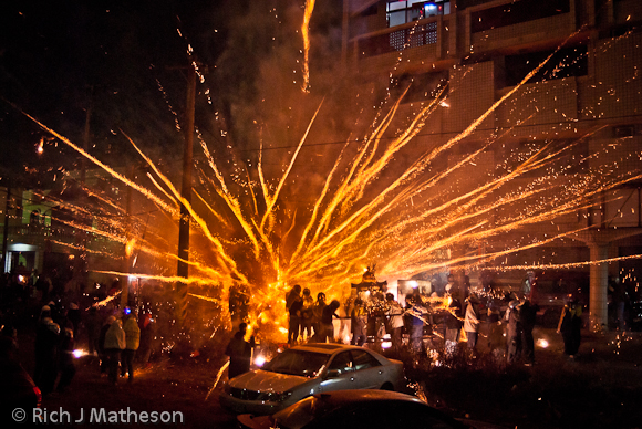 fireworks and bottle rockets blast gods in palanquins