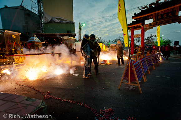 Firecrackers are set off prior to the small wall, Yanshui Beehive Fireworks Festival