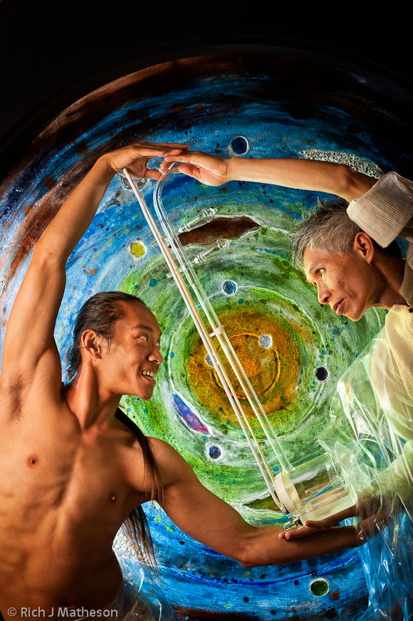 Dancer Billy Chang with colored glass art window and glass erhu player